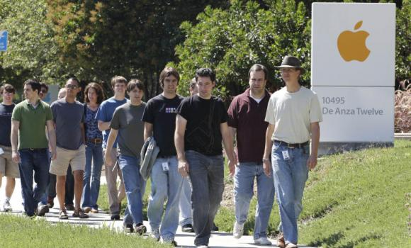 Apple employees walk between buildings at Apple headquarters in Cupertino, California.