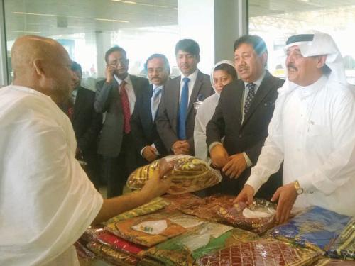 Bangladeshi Ambassador Md Shahidul Islam and Saudi and Bangladeshi officials receive the first group of Bangladeshi pilgrims who arrived at the Haj terminal of King Abdulaziz International Airport in Jeddah on Wednesday.