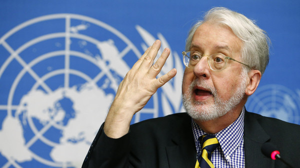 Chief investigator Paulo Pinheiro, a member of the Independent International Commission of Inquiry on the Syrian Arab Republic, attends a news conference at the United Nations headquarters in Geneva August 27, 2014.