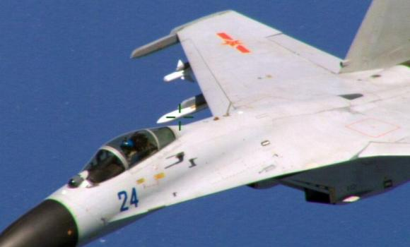 This image obtained August 22, 2014, courtesy of the Department of Defense shows a Chinese fighter jet in a photo taken by a US Navy P-8 crew.