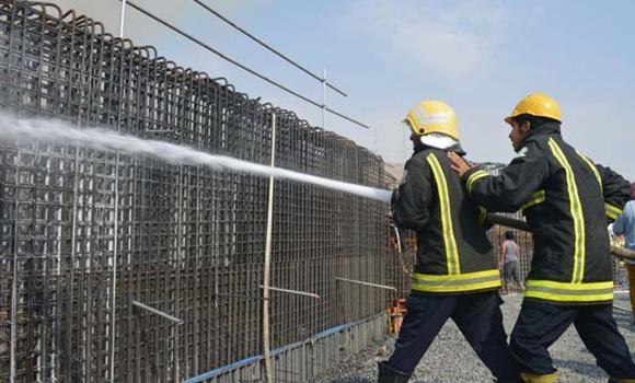 Civil defense personnel attempting to extinguish a fire that break out in Haram expansion site.