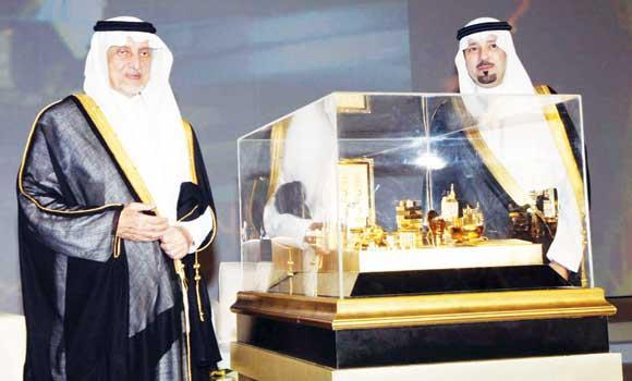 Education Minister Prince Khaled Al-Faisal receives an award of excellence from Makkah Gov. Prince Mishaal bin Abdullah in Jeddah on Tuesday.