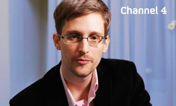 An undated handout photo received from Channel 4 on December 24, 2013 shows US intelligence leaker Edward Snowden preparing to make his television Christmas message.