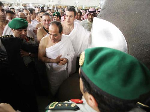 A handout picture released by the Egyptian Presidency shows Egypt's President Abdel Fattah Al-Sisi (C) performing the mini-pilgrimage, known in Arabic as Umrah, in the holy Saudi city of Makkah on Monday.