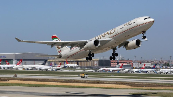 "Etihad Airways is re-routing its flights to avoid ""conflict airspace"" in Iraq."