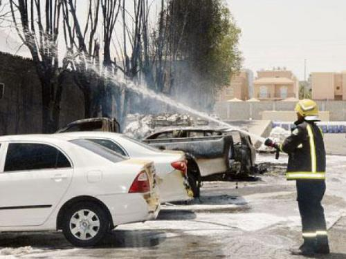 Firefighters douse the fire that erupted at a gas station some 35 kilometers away from Taima