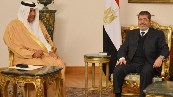 Ousted president Mohamed Morsi meets with former Foreign Minister and Prime Minister Hamad bin Thani.