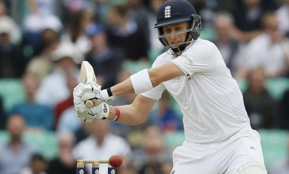 England's Joe Root goes to hit four runs off a ball bowled by India's Ishant Sharma during the third day of the fifth test cricket match at Oval cricket ground in London.