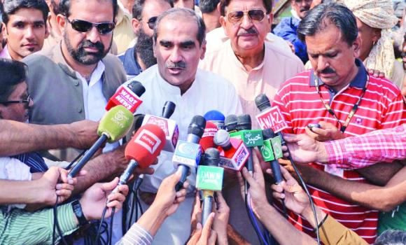 Khawaja Saad Rafique, center, from the ruling PML-N, speaks to media after meeting with Tahirul Qadri amid ongoing anti-government protests in Islamabad on Sunday.