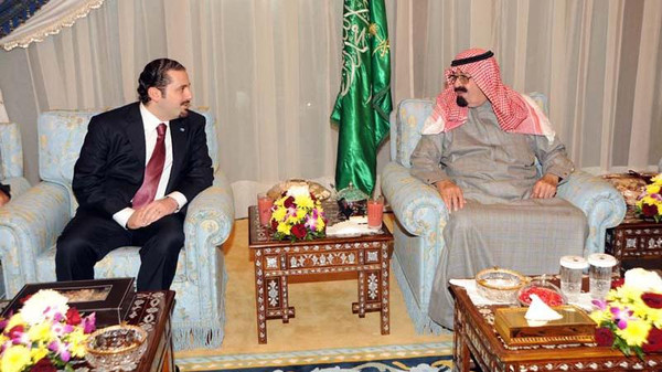 King Abdullah bin Abdulaziz (right) with previous Lebanese Prime Minister Saad Hariri (left).