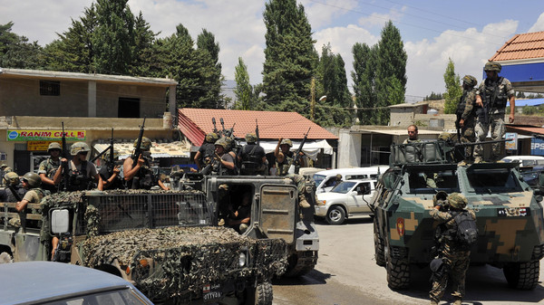 Lebanese army soldiers ride military vehicles, in Labwe in eastern Bekaa Valley August 6, 2014.