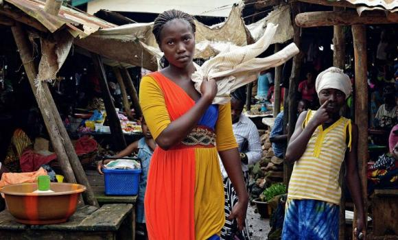 Locals stand at a market in Kenema, Sierra Leone.