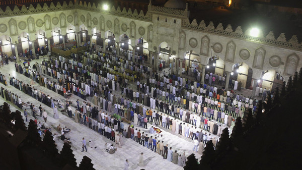 Muslims conduct taraweeh prayers as they gather specially for Lailat al-Qadr, at Al-Azhar Mosque in Cairo July 24, 2014.