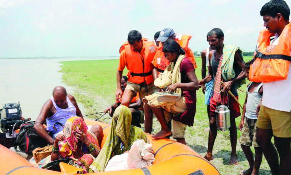 National Disaster Response Force (NDRF) personnel evacuate villagers at Supaul district in the eastern Indian state of Bihar on Sunday.