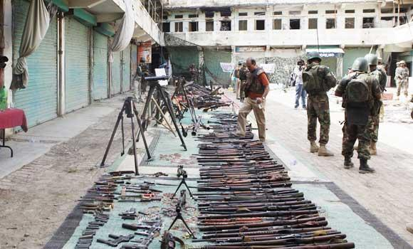 In this July 9, 2014 photo, Pakistan army display ammunition reportedly captured from militants in Miran Shah in North Waziristan, Pakistan.