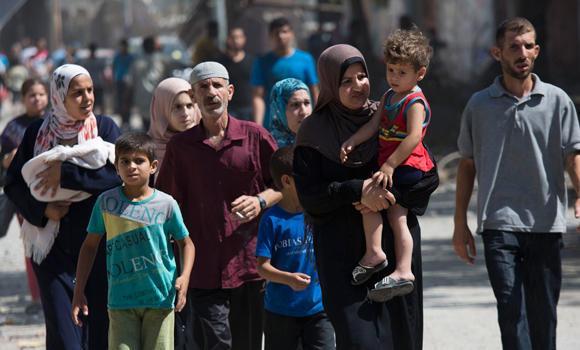 Palestinians return to the heavily bombed Gaza City neighborhood of Shijaiyah, close to the Israeli border.