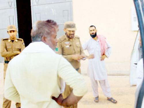 Security officers verify IDs of foreign workers in Buraidah during the crackdown last week