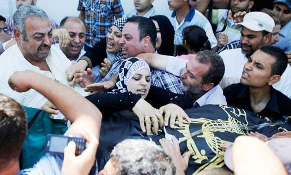 Palestinians carry the body of Islamic Jihad militant Shaaban Al-Dahdouh, which was found under the rubble yesterday, during funeral in Gaza City, on Wednesday.