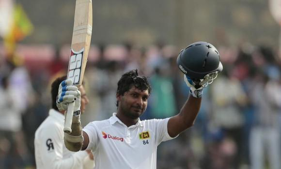 Sri Lankan cricketer Kumar Sangakkara celebrates scoring a double century during the fourth day of the first Test cricket match between Sri Lanka and Pakistan in Galle, Sri Lanka, Saturday.