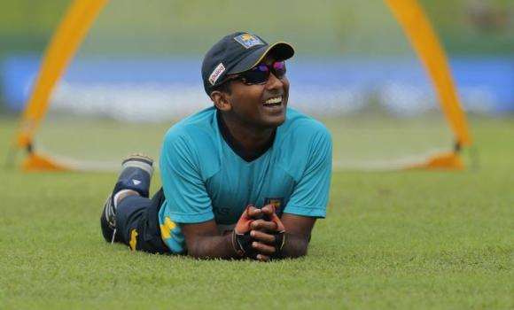 Sri Lankan cricketer Mahela Jayawardene smiles at a teammate as he attends a practice session on the eve of their second Test cricket match against Pakistan, which is also his final Test, in Colombo, Wednesday. One of cricket's most elegant and enduring batsmen, Jayawardene, has 11,756 runs from 250 Tst innings and has posted 34 test centuries and 49 half centuries.