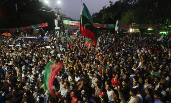Supporters of Pakistan's cricketer-turned-politician Imran Khan gather to march to Islamabad from Lahore.