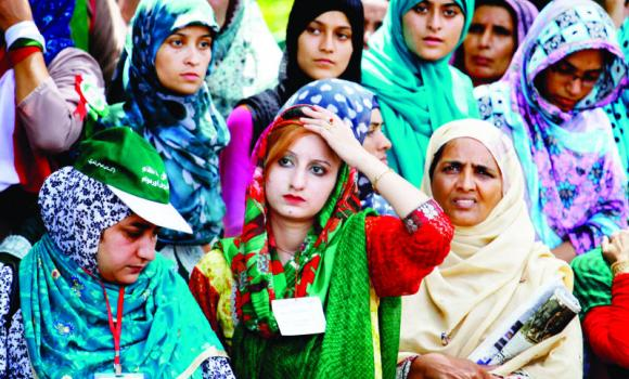 Supporters of Tahirul Qadri wait for their leader during Sunday's protest in Islamabad.