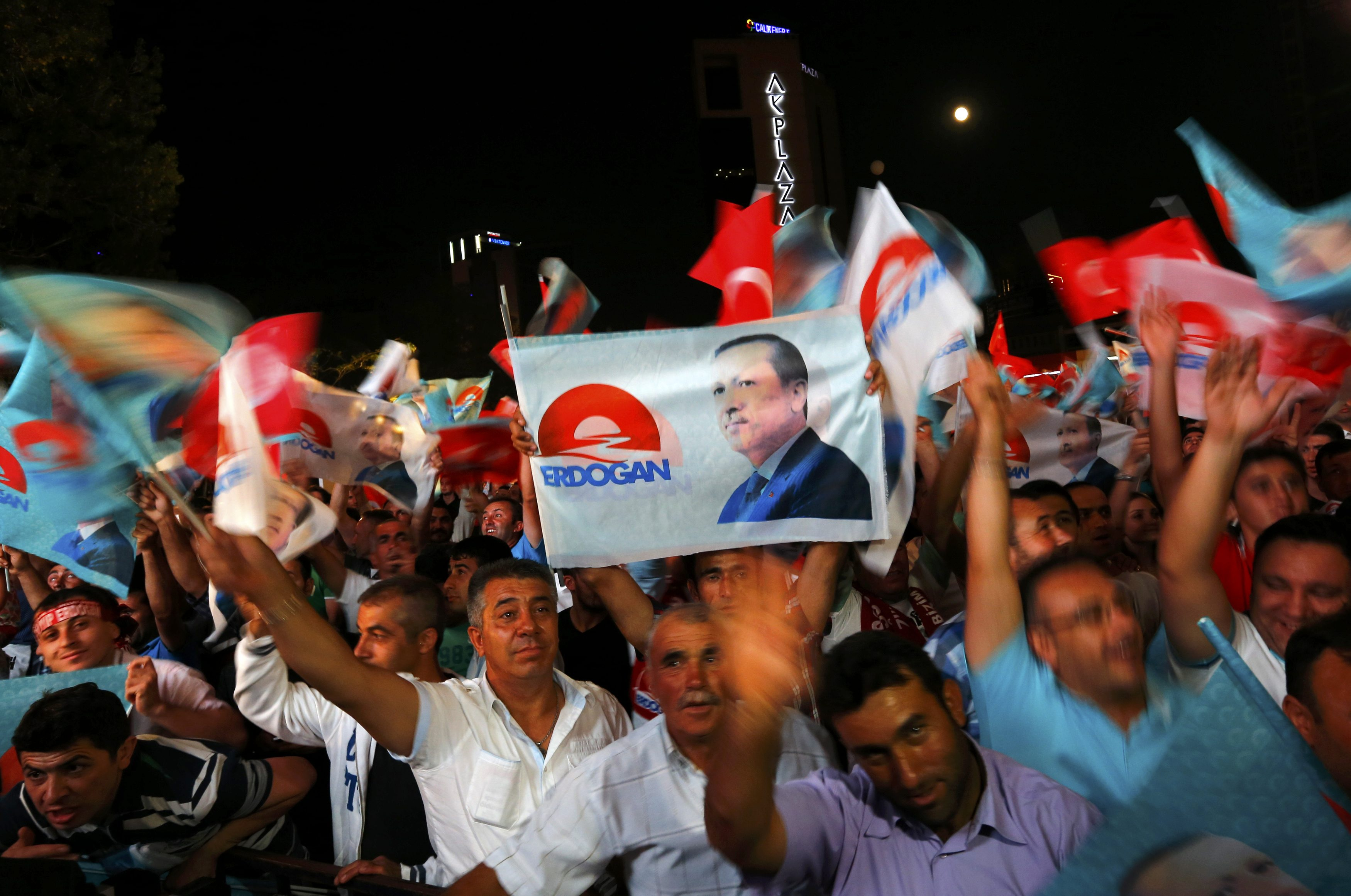 Supporters of Turkey's Prime Minister Tayyip Erdogan celebrate his election victory in front of the party headquarters in Ankara August 10, 2014.