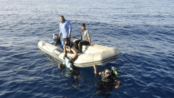 The migrants were found off the shores of al-Qarbouli, 50 kilometers (30 miles) east of Tripoli.