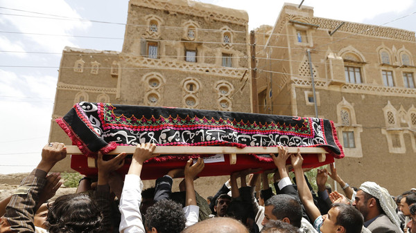 Mourners carry the coffin of a soldier, who was killed by al Qaeda militants in the Wadi Hadramout region in northeastern Yemen, during his funeral in Sanaa.