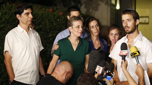 Zur Goldin (R), brother of Israeli soldier Hadar Goldin, and other family members talk to the media outside their home in the central Israeli city of Kfar Saba August 2, 2014.