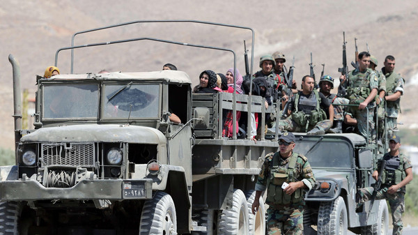 At least 13 soldiers have been killed in the fighting in the northeastern border town of Arsal.