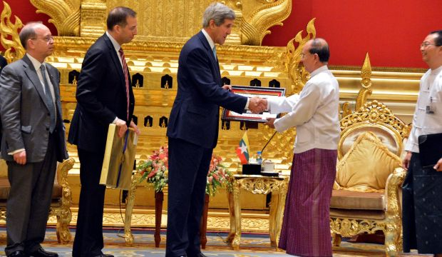 Myanmar president Thein Sein shakes hands with US Secretary of State John Kerry after their meeting at the President Office in Naypyitaw, Myanmar, on August 9, 2014.