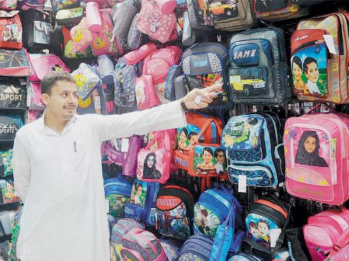 Parents question why bags with cartoon characters printed on them are sold in stores when such bags are banned in schools.