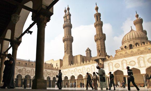 In this Dec. 28, 2012 file photo, Muslims arrive to attend the Friday prayer at Al-Azhar mosque in Cairo, Egypt.