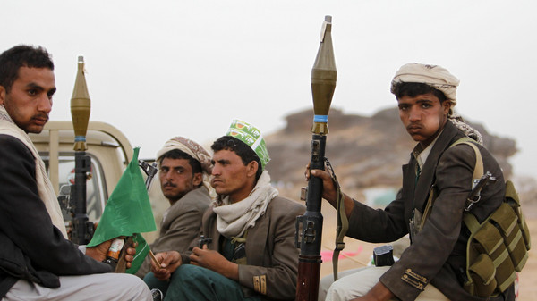 Armed followers of Yemen's Shi'ite Houthi group sit on a truck patrolling the vicinity of a ceremony attended by fellow Shi'ites in Dhahian of the northwestern Yemeni province of Saada Feb. 3.
