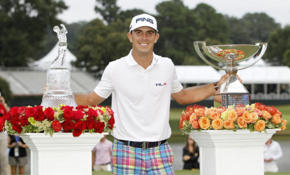Billy Horschel stands with the Tour Championship trophy and FedEx Cup after winning the Tour Championship at East Lake Golf Club on Sunday.