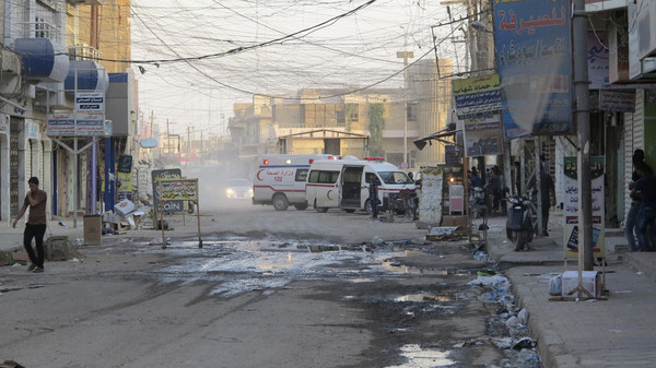 Ambulances arrive to transport people injured in a suicide bombing in the center of Ramadi, western Anbar province.