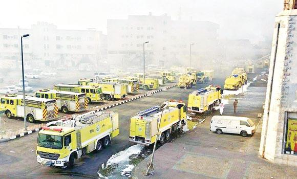 Fire trucks take part in the operation to put out the blaze in Dammam.