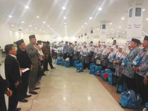 Indonesian officials receive the first group of Haj pilgrims from the country at Madinah airport on Monday.
