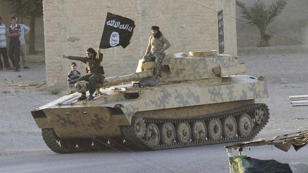 Islamist fighters taking part in a military parade along the streets of Syria's northern Raqqa province .