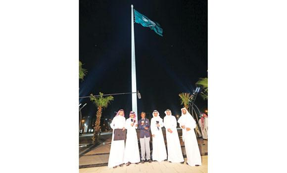 Officials proudly launch the world's tallest flagpole on Tuesday in Jeddah.