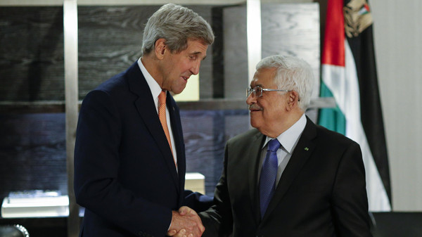 U.S. Secretary of State John Kerry (L) shakes hands with Palestinian President Mahmoud Abbas during a bilateral meeting on September 23, 2014 at the Hyatt Hotel in New York.
