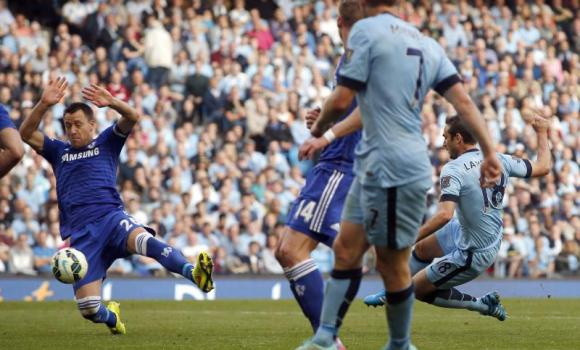 Manchester City's Frank Lampard, right, scores scored the equalizer against Chelsea during their English Premier League soccer match at the Etihad stadium in Manchester on Sunday.
