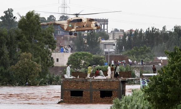 A Pakistani army helicopter hovers to rescue trapped people marooned by floods on the outskirts of Islamabad on Friday.