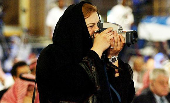 In this file photo, a Saudi photographer films during the Jeddah Economic Forum in Jeddah.