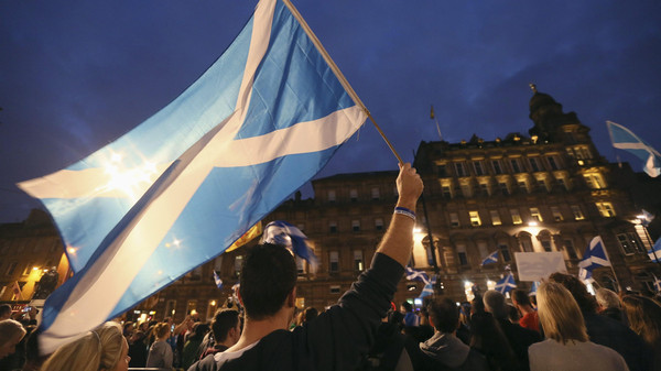 'Yes' campaigners holding Scottish Saltire flags gather for a rally in George Square, Glasgow, Scotland September 17, 2014.