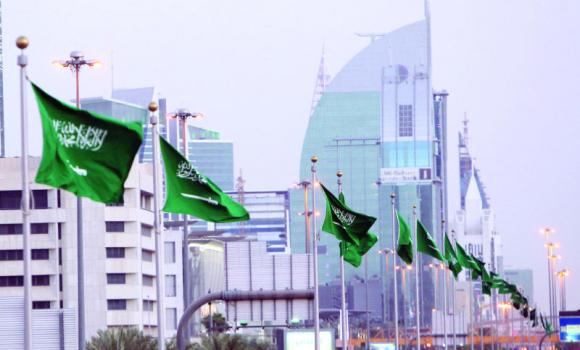 A street in the capital is decked with the Saudi national flag ahead of Tuesday's celebrations.
