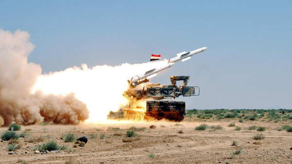 An undated handout photo distributed by Syrian News Agency (SANA) on July 9, 2012 shows a missile being launched from a mobile platform during a live ammunitions exercise by Syrian air defence forces in an undisclosed location.