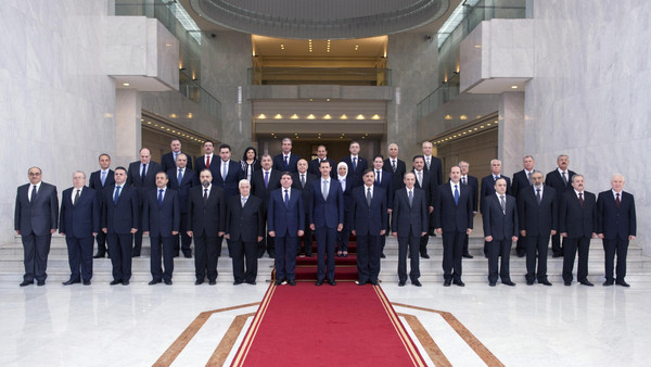 Syria's President Bashar al-Assad (front C) poses for a photo with members of his new cabinet in Damascus August 31, 2014 in this picture released by Syria's national news agency SANA.
