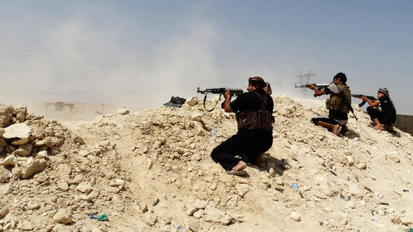 Tribal fighters fire their weapons during an intensive security deployment to fight against ISIS in Iraq.